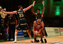 Jordan Davis of Bristol Flyers in action with Eric Eaves of Plymouth Raiders and Zak Wells of Plymouth Raiders - Photo mandatory by-line: Alex James/JMP - 25/02/2018 - BASKETBALL - Plymouth Pavilions - Plymouth, England - Plymouth Raiders v Bristol Flyers - British Basketball League