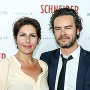 NLD/Amsterdam/20150525 - Premiere Schneider & Bax,  Belgische acteur Tom Dewispelaere (R) en zijn vrouw en actrice Tiny Bertels