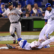 Kansas City Royals first baseman Eric Hosmer lunged to tag first base for an out ahead of San Francisco Giants Gregor Blanco in the third inning in Game 2 of the World Series on Wednesday, October 22, 2014 at Kauffman Stadium in Kansas City, Mo.
