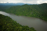 Aerial view of Mamberamo River, Papua, Indonesia, lined by rain forest, with Foja Mountains in the distance.
