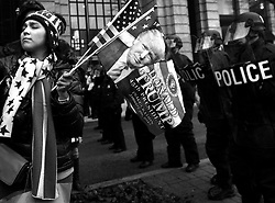 January 20, 2017 - Washington, DC, U.S - JADE BAI, a Trump supporter holds flags as protesters and police clash during President Donald Trump's inauguration in Washington, D.C., on Jan. 20, 2017. (Credit Image: © Carol Guzy via ZUMA Wire)