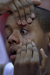 28 November 2009: Kellen Thornton's contact lens is stuck to his cheek as he holds his eyes open and awaits assistance from athletic trainer John Munn. The Redhawks of SouthEast Missouri State fall the Redbirds of Illinois State 93-53 on Doug Collins Court inside Redbird Arena in Normal Illinois.