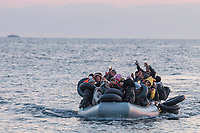 LESVOS, GREECE - FEBRUARY 09: Refugees wave their hands after crossing the Aegean sea from the Turkish coast to a beach on the south of Lesvos on February 09, 2015 in Lesvos, Greece. Photo: © Omar Havana. All Rights Are Reserved