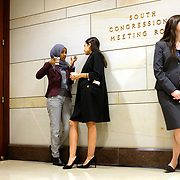 Rep.-elect Omar Ilhan (D-Minn.), left, speaks to Rep.-elect Alexandria Ocasio-Cortez (D-N.Y.) between new-member orientation briefings on Thursday, November 15, 2018.