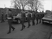 Body of Private Stephen Griffin killed in Lebanon is returned to his home soil..1980-04-19.19th April 1980.19-04-1980.04-19-80..Photographed at Arbor Hill:..Guard of honour from the Ist Field Engineers Company, Cork, colleagues of the late Private Stephen Griffin, acompany the hearse at Arbor Hill, Dublin.