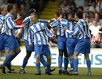 Photo Aidan Ellis, Digitalsport<br /> NORWAY ONLY<br /> <br /> Lincoln City v Huddersfield Town.<br /> Third Divison Play Off Semi Final 1st leg.<br /> 15/05/2004.<br /> Huddersfield Goal scorer Iffy Onuora leads the celebrations after scoring the first goal