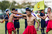 "24 JULY 2014 - BANGKOK, THAILAND: Students reenact historic Thai battles during a patriotic parade at the happiness party on Sanam Luang. The Thai Junta is organizing a series of public events throughout Thailand meant to bolster public opinion. The events are called ""restoring happiness to the people"" parties. They feature historic pageants, music, food, health checks and free haircuts. The party in Bangkok is on Sanam Luang, the Royal Parade Ground, which is near the Grand Palace and the Ministry of Defense.    PHOTO BY JACK KURTZ"