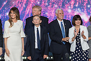 GOP Presidential candidate Donald Trump stands with running mate Gov. Mike Pence and family members after accepting the party nomination for president on the final day of the Republican National Convention July 21, 2016 in Cleveland, Ohio.