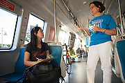 Loretta Seto of San Jose, left, talks with BART Senior Research Project Analyst Angela Borchardt about the new BART trains during the BART Fleet of the Future public survey at VTA's Great Mall Main Transit Center in Milpitas, California, on May 2, 2014. (Stan Olszewski/SOSKIphoto)