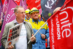 © Licensed to London News Pictures. 25/05/2016. London, UK. Tata steelworkers and hundreds of steelworkers from across the UK march through Westminster in London to keep up pressure for government help steel industry on Wednesday, 25 May 2016. Photo credit: Tolga Akmen/LNP