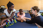 Dr Siobhan Neville examines 2 year old Husha who has anaemia and malaria on the children's ward during the daily rounds.  The rounds are attended by all the medical staff who work on that ward, doctors, nurses and attendants.St Walburg's Hospital, Nyangao. Lindi Region, Tanzania.