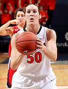 CHARLOTTESVILLE, VA- December 7: Chelsea Shine #50 of the Virginia Cavaliers shoots a free throw during the game against the Liberty Lady Flames on December 7, 2011 at the John Paul Jones arena in Charlottesville, Va. Virginia defeated Liberty 64-38. (Photo by Andrew Shurtleff/Getty Images) *** Local Caption *** Chelsea Shine