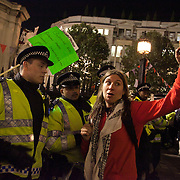 A woman is given police a hard time for their tactics. The London Stock Exchange was attempted occypied in solidarity with Occupy Wall in Street in New York and in protest againts the economic climate, blamed by many on the banks. Police managed to keep people away fro the Patornoster Sqaure and the Stcok Exchange and thousands of protestors stayid in St. Paul's Square, outside St Paul's Cathedral. Many camped getting ready to spend the night in the square.