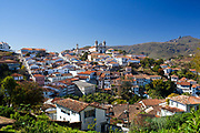 Wide angle view of the city. Colourful Colonial buildings in the city centre of Ouro Preto, in the state of Minas Gerais, Brazil. Ouro Preto, meaning black gold, was an important mining town especially during the Brazilian gold rush in the 1700s. It is now a UNESCO heritage site due to the excellent examples of Baroque architecture.