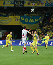 October 9, 2017 - Kiev, Ukraine - Ukraine's Yevhen Konoplyanka (R) in action against Croatia's Matej Mitrovic (C) during the FIFA 2018 World Cup Group I Qualifier between Ukraine and Croatia at Kiev Olympic Stadium on October 9, 2017 in Kiev, Ukraine. Ukraine fail to reach the play-offs as they lose 2-0. (Credit Image: © Sergii Kharchenko/NurPhoto via ZUMA Press)