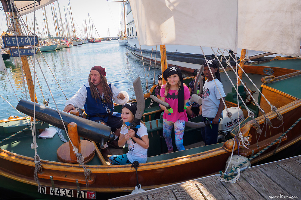 North America, United States, Washington, Port Townsend. Pirate and children boat at annual Wooden Boat Festival.