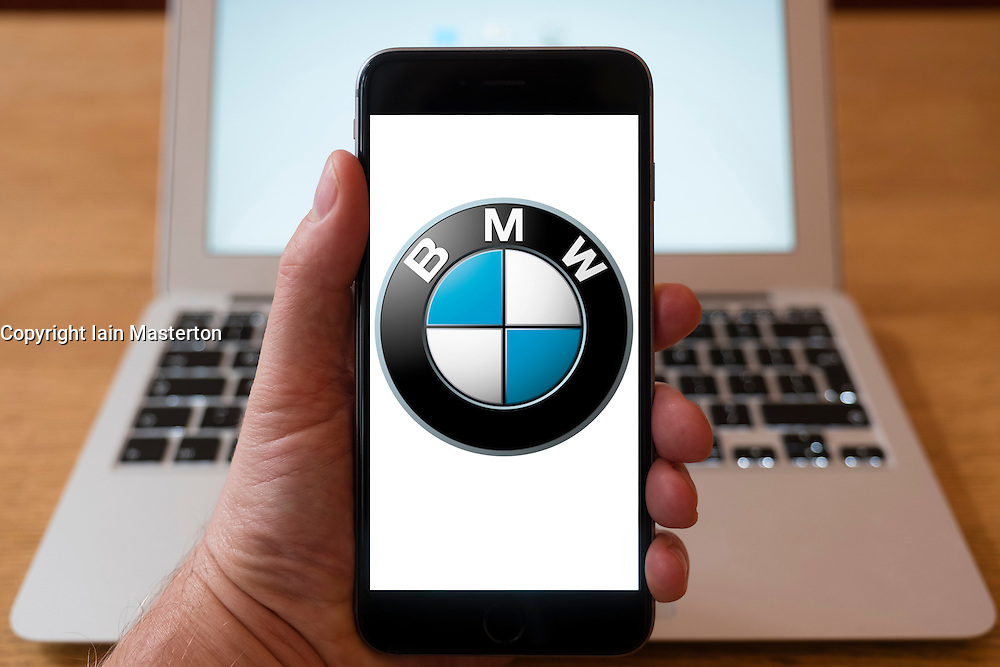 Using iPhone smartphone to display logo of BMW vehicle manufacturer