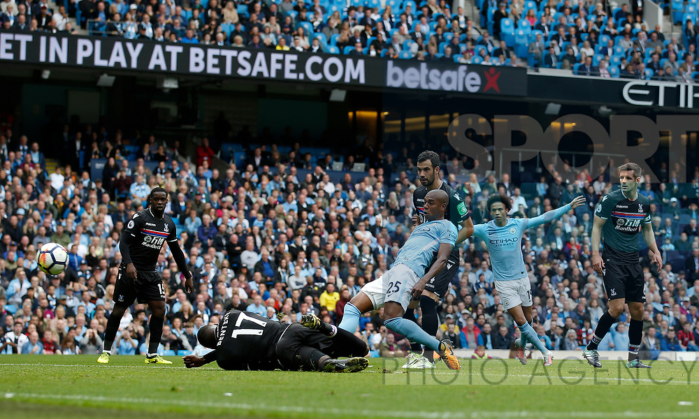 Fernandinho of Manchester City shoots as Christian Benteke of Crystal Palace lies on the ground during the premier league match at the Etihad Stadium, Manchester. Picture date 22nd September 2017. Picture credit should read: Simon Bellis/Sportimage
