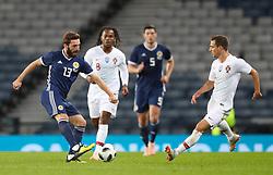 Scotland's Graeme Shinnie (left) in action during the International Friendly match at Hampden Park, Glasgow.