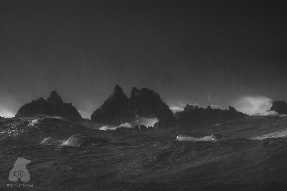 Waves crashing on the jagged rocks of Lyall Bay, Wellington, New  Zealand.