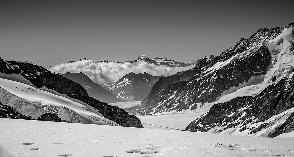 Looking down to the Aletch glacier from the Jungfraujoch at 3,466 metres (11,371 ft). The largest glacier in the Alps (about 23 km / 14 miles long) is still around 1km thick in parts and if you are lucky, to hike and spend time out under clear night skies.