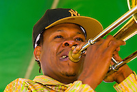 Musician playing trombone, Lil' Rascals, French Quarter Festival, Woldenberg Riverfront Park, New Orleans, Louisiana, USA