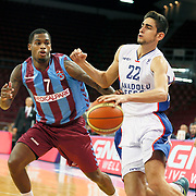 Anadolu Efes's Furkan Korkmaz (R) and Trabzonspor's Dwight Hardy (L) during their Turkish Basketball League match Anadolu Efes between Trabzonspor at Abdi Ipekci Arena in Istanbul Turkey on Sunday 19 October 2014. Photo by Aykut AKICI/TURKPIX