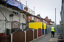 © Licensed to London News Pictures. 23/09/2013. Derby, UK. Pictured, Contractors begin work on Number 18, Victory Street, Derby, the house wher six children died in a house fire set by by their parents was starting to be demolished today. Photo credit : Dave Warren/LNP
