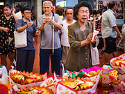 01 FEBRUARY 2017 - BANGKOK, THAILAND: People pray during Lunar New Year observances at the Poh Teck Tung Shrine in Bangkok. This is the Year of the Rooster in the Chinese zodiac and people pray and make merit to large statues of roosters in Chinese temples and shrines.     PHOTO BY JACK KURTZ