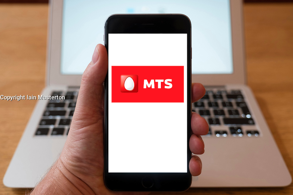 Using iPhone smartphone to display logo of MTS Russian mobile phone provider