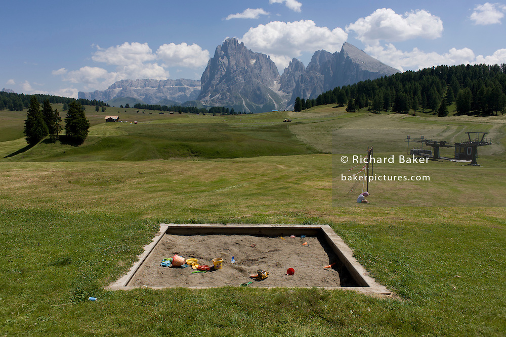 Childrens' sandpit landscape on the Siusi plateau, above the South Tyrolean town of Ortisei-Sankt Ulrich in the Dolomites, Italy.