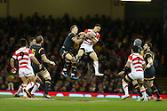 Liam Williams of Wales jumps for a high ball with Akihito Yamada of Japan. Under Armour 2016 series international rugby, Wales v Japan at the Principality Stadium in Cardiff , South Wales on Saturday 19th November 2016. pic by Andrew Orchard, Andrew Orchard sports photography