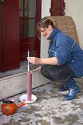 Measuring must weight in a test cylinder. Chateau Grand Corbin Despagne, Saint Emilion Bordeaux France
