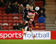 Ben Gibson of Middlesbrough  and Leeds United midfielder Ezgjan Alioski contest an aerial ball  during the EFL Sky Bet Championship match between Middlesbrough and Leeds United at the Riverside Stadium, Middlesbrough, England on 2 March 2018. Picture by Paul Thompson.