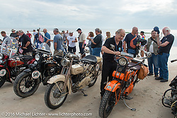 Michel Magnin adjusts his ride chart on his 1926 Harley-Davidson J on the sands of Daytona Beach for the official start of stage 1 of the Motorcycle Cannonball Cross-Country Endurance Run, which on this day ran from Daytona Beach to Lake City, FL., USA. Friday, September 5, 2014.  Photography ©2014 Michael Lichter.