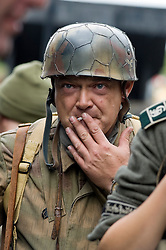 Reenactor from Northern World War Two Association, portraying a member of the 1st Fallschirmjaeger Division 'The Green Devils' prepares for a battle reenactment at Elsecar 1940s Weekend <br /> 4 September 2010<br /> Images © Paul David Drabble