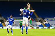 Birmingham City's Marc Roberts (4) competes for a high ball with Cardiff City's Sean Morrison (4) during the EFL Sky Bet Championship match between Cardiff City and Birmingham City at the Cardiff City Stadium, Cardiff, Wales on 16 December 2020.