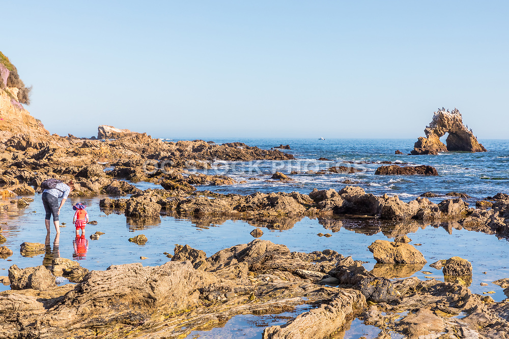 A Lady and Small Child Looking at the Tide Pools in Corona del Mar