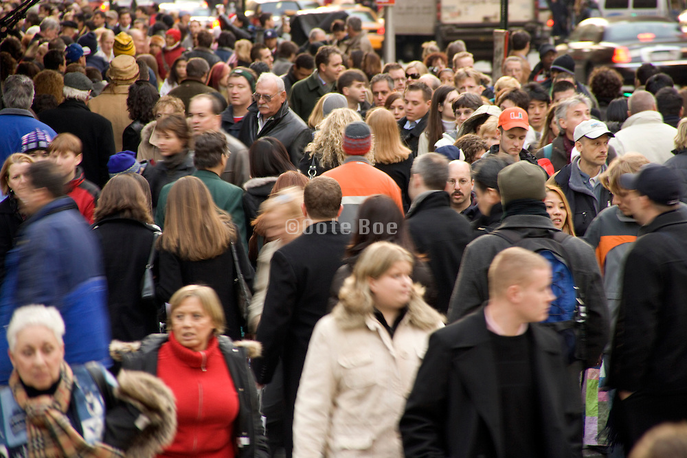 Christmas shopping crowd in Mid Town Manhattan New York City