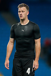 Ryan Taylor of Newcastle United looks relieved as he leaves the pitch having played a part in a 0-2 win during  his first competetive game for 26 months after suffering a cruciate ligament injury - Photo mandatory by-line: Rogan Thomson/JMP - 07966 386802 - 29/10/2014 - SPORT - FOOTBALL - Manchester, England - Etihad Stadium - Manchester City v Newcastle United - Capital One Cup Fourth Round.