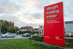 © Licensed to London News Pictures. 23/10/2020. Slough, UK. A large red 'slough trading estate' sign on Farmham Road, Slough. Slough will move to Local COVID Alert Level: High (Tier 2) at 00:01 BST on Saturday 24th October 2020 after an increase in people infected with the COVID-19 coronavirus. Photo credit: Peter Manning/LNP