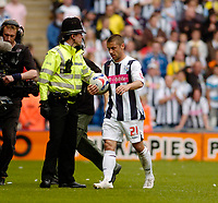 Photo: Leigh Quinnell.<br /> West Bromwich Albion v Barnsley. Coca Cola Championship. 06/05/2007. West brom hat trick hero Kevin Phillips takes the ball home.