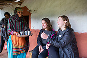 UK volunteers Polly Armstrong & Elinor Griffiths having a cup of tea made by their host mum at their homestay. Devichou, Karyabinayak, Nepal. ICS / Restless Development volunteers in the Dakshinkali region of Nepal. (© Andy Aitchison / ICS)