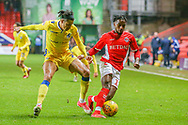 Bristol Rovers defender Daniel Leadbitter (2) attempts to tackle Charlton Athletic midfielder Tariqe Fosu (11) during the EFL Sky Bet League 1 match between Charlton Athletic and Bristol Rovers at The Valley, London, England on 24 November 2018.