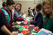 Michell Eacret helps Girl Scouts Christina Wamsley, 11, left, Avishkrita Nakka, 10, and Isabelle Doyle, 9, right, sort and bundle Holiday Cards created special for the U.S. Military during the Girl Scout USA of Northern California Operation Holiday Cards packing event at Mount Olive Ministries in Milpitas, California, on November 18, 2015. Eacret created Operation Holiday Cards 13 years ago, and now helps generate more than 6,000 cards for the U.S. Military. (Stan Olszewski/SOSKIphoto)