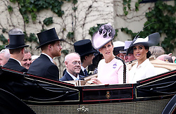 The Duke and Duchess of Sussex and Sophie the Countess of Wessex (centre) during day one of Royal Ascot at Ascot Racecourse.