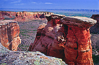 """Kayenta Formation or """"Caprock"""" resting atop a Wingate Sandstone monolith in Monument Canyon. Colorado National Monument.  Colorado, USA."""