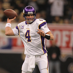 Jan 24, 2010; New Orleans, LA, USA; Minnesota Vikings quarterback Brett Favre (4) throws against the New Orleans Saints during the first quarter of the 2010 NFC Championship game at the Louisiana Superdome. Mandatory Credit: Derick E. Hingle-US PRESSWIRE