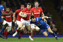 Wale's Gareth Davies (left) tackled by France's Maxime Machenaud (right) during the NatWest 6 Nations match at the Principality Stadium, Cardiff.