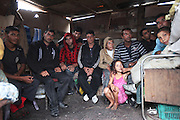 These Roma Gypsies were residents of an infamous municipal building tower block with windows, which was the bone of controversy for many years. The building was knocked down in September 2010 and its residents forcibly evicted. The municipality refused to rehouse them. They live adjacent to the old building in homemade squats. Their shacks are surrounded by a vast municipal estate housing non-Roma. On the outskirts of Yambol Bulgaria..Roma Gypsies left India 1000 years ago. Often nomadic. A collection of tribes with their own languages and culture, pushed by the Ottoman empire towards Europe, used and sold as mercenaries, slaves, prostitutes. They endured 500 years of slavery until mid 19th century. A million were killed in the holocaust. Hundreds of thousands exiled and refugees from kosovo. Many Eastern Europe Roma come to the west seeking a better life. They are shunned, marginalized, excluded. Both indigenous and foriegn Roma, whether European citizens or not, lack the opportunities of others, living on the periphery, in the brunt of racism, often deported back to their countries of origin.